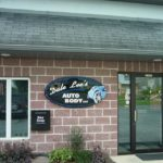 dale lees auto body sign